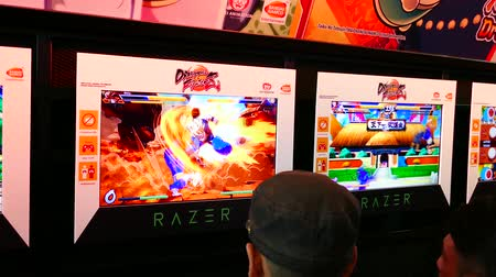 BANGKOK, THAILAND - NOVEMBER 5: Promotion screen of DragonBall Fighter Z game demo in gaming booth in Thailand Game Show Big Festival on November 5, 2017. DragonBall Fighter Z is an action fighting game from Bandai Namco and which will be release in 2018.