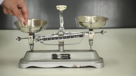 Two-arm scales equipment tool in science laboratory used for weighing and balancing methods for quantities measure in biology lab test education.