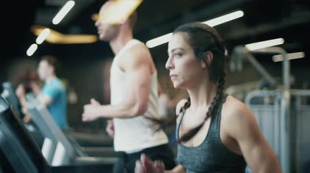 elliptical : Couple using running machine at the gym