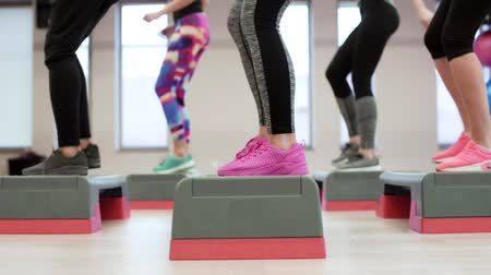 move well : Low section view of step aerobics Stock Footage
