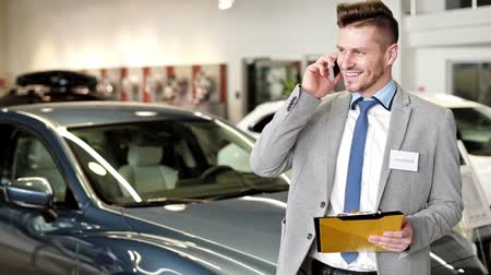 persuasion : Salesman talking on mobile phone
