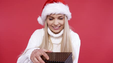 surprised : Surprised woman opening christmas present