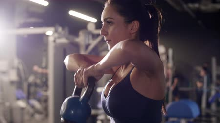 crouch : Woman using kettlebell at gym Stock Footage