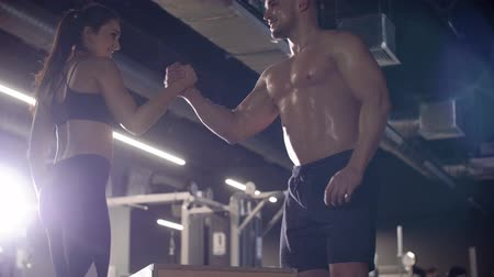 crouch : Couple exercising at the gym Stock Footage