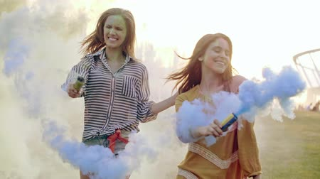 friendship dance : Friends with smoke bomb dancing at the summer festival Stock Footage