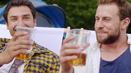 markiza : Two buddies drinking beer at the summer festival Wideo