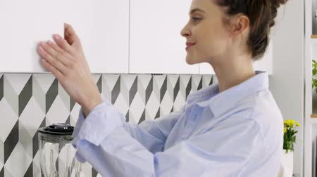 drinking coffee : Happy, young woman making coffee in her home Stock Footage
