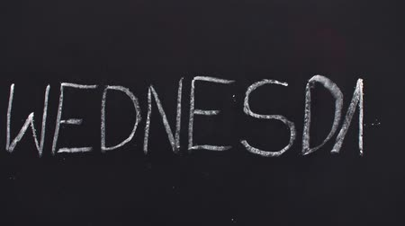 tablica : Word wednesday written on the blackboard Wideo