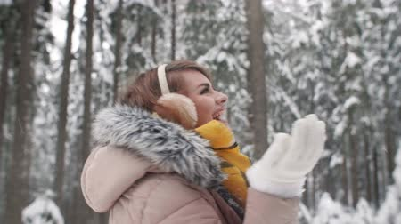 earmuffs : Woman having a fun in forest