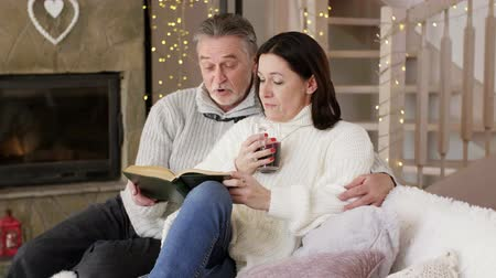 tribute : Embraced mature couple reading a book