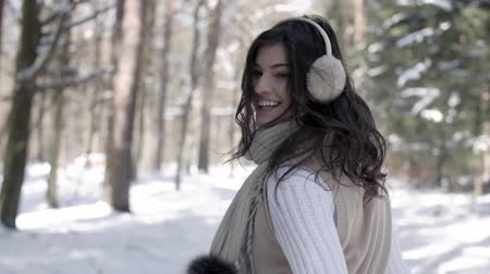 earmuffs : Woman walking in forest