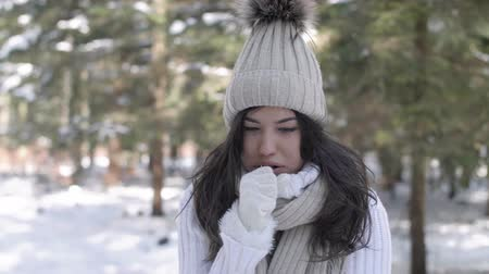 uncomfortable : Sick woman coughing in winter