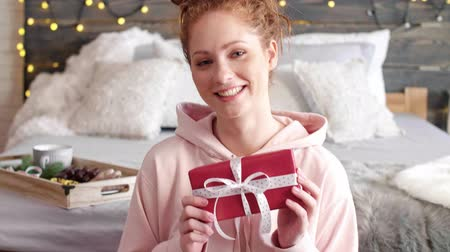 wrapped up : Smiling girl showing the christmas presents Stock Footage