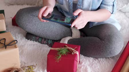 section : Woman wrapping the christmas presents