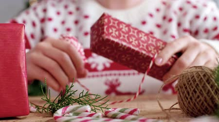wrapped up : Girl preparing gifts for Christmas