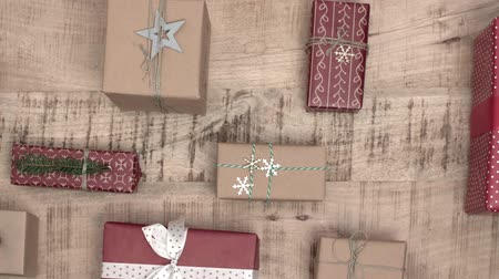 wrapping paper : A lot of christmas gifts on wooden background Stock Footage