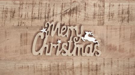 sal : Text Merry Christmas on wooden table Stok Video