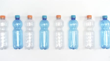 stop motion : Plastic bottles in a row for recycling Stock Footage
