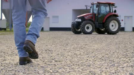 him : Low section of farmer walking on the farm Stock Footage