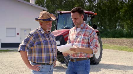 tribute : Two farmers analyzing data from the clipboard on the farm