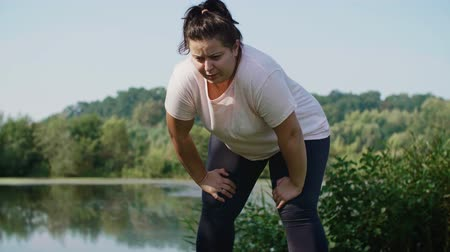 overweight : Woman running in public park