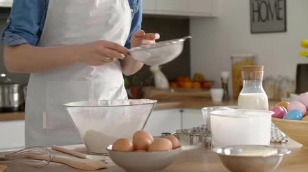 sifting : Woman sifting flour in the kitchen Stock Footage