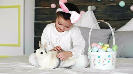 rabbit ears : Child and her rabbit celebrating Easter in bed