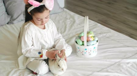 rabbit ears : Child and rabbit spending easter morning in bed