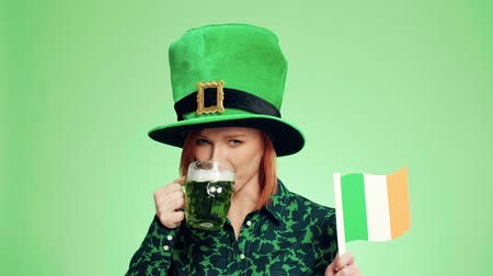 tribute : Happy woman with Irish flag drinking beer Stock Footage