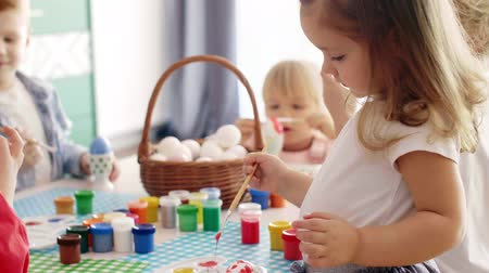easter : Handmade easter eggs painted by group of children Stock Footage