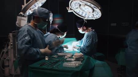 scalpel : Time lapse view of the difficult operation of busy surgeons