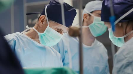 transplant : Group of surgeons at the work