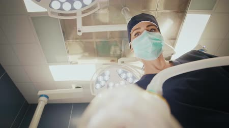 surgical light : Low angle view of young anesthesiologist at work