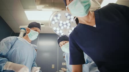 surgical light : Team of surgeons at operating room