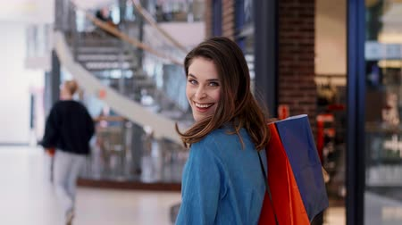 tribute : Portrait of joyful woman with full shopping bags