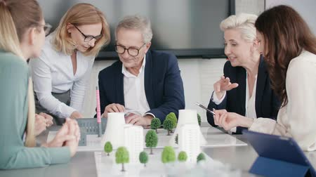 construction work : Business people over architectural model
