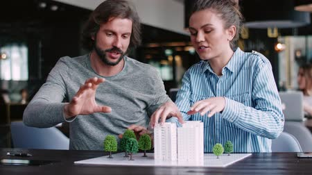 environmentalist : Architectural model and young adults architects Stock Footage