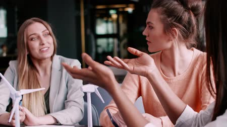 bir genç kadın sadece : Female coworkers having a conversation at a business meeting