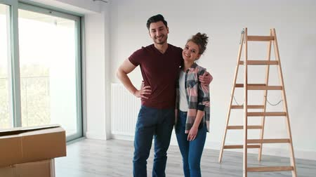 camera move : Portrait of smiling couple moving in new flat