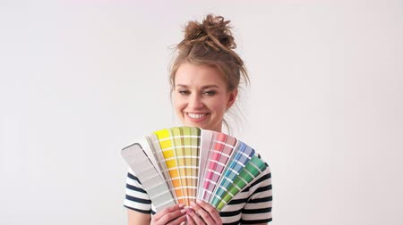 color swatch : Portrait of smiling woman showing paint swatches