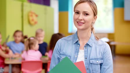 Smiling female teacher in the preschool