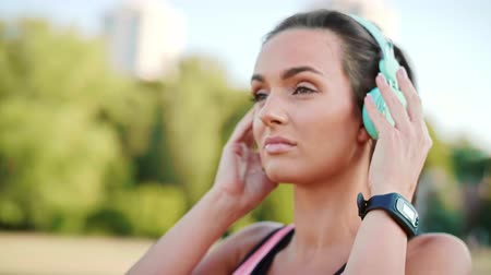 Beautiful woman listening to music during jogging