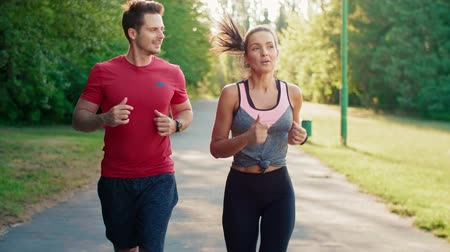 talc : Couple jogging during sunny afternoon