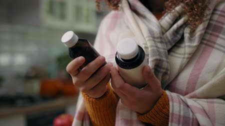 dose : Woman holding bottles of remedy for her illness Stock Footage