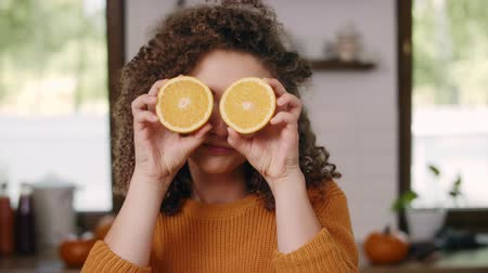 tribute : Both eyes covered with orange slices Stock Footage