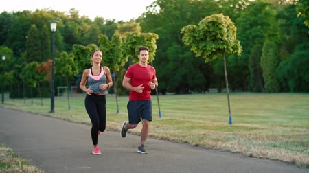 верный : Young couple jogging together in the park
