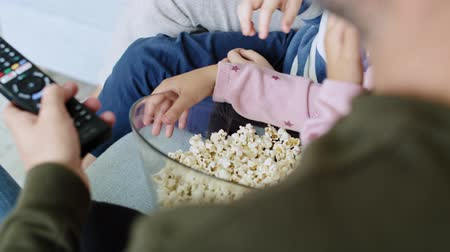 sieves : Close up of family eating popcorn Stock Footage