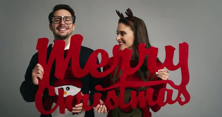 výstřední : Funny couple wishing Merry Christmas to all