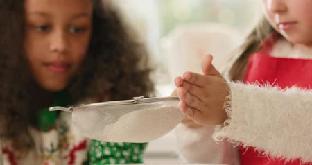 sifting : Close up of little girl sifting flour