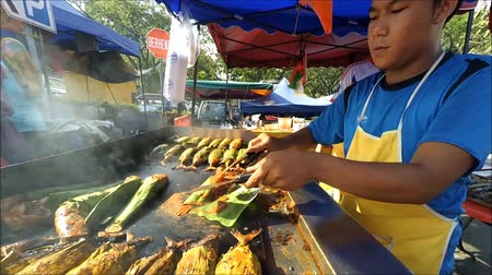 stragan : Kuala Lumpur,Malaysia - July 6, 2015: Tasty grilled fish cooking by the hawker in Ramadan Bazaar during the holy month of Ramadan.